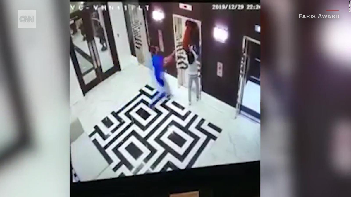 Man saves a dog whose leash got stuck in an elevator